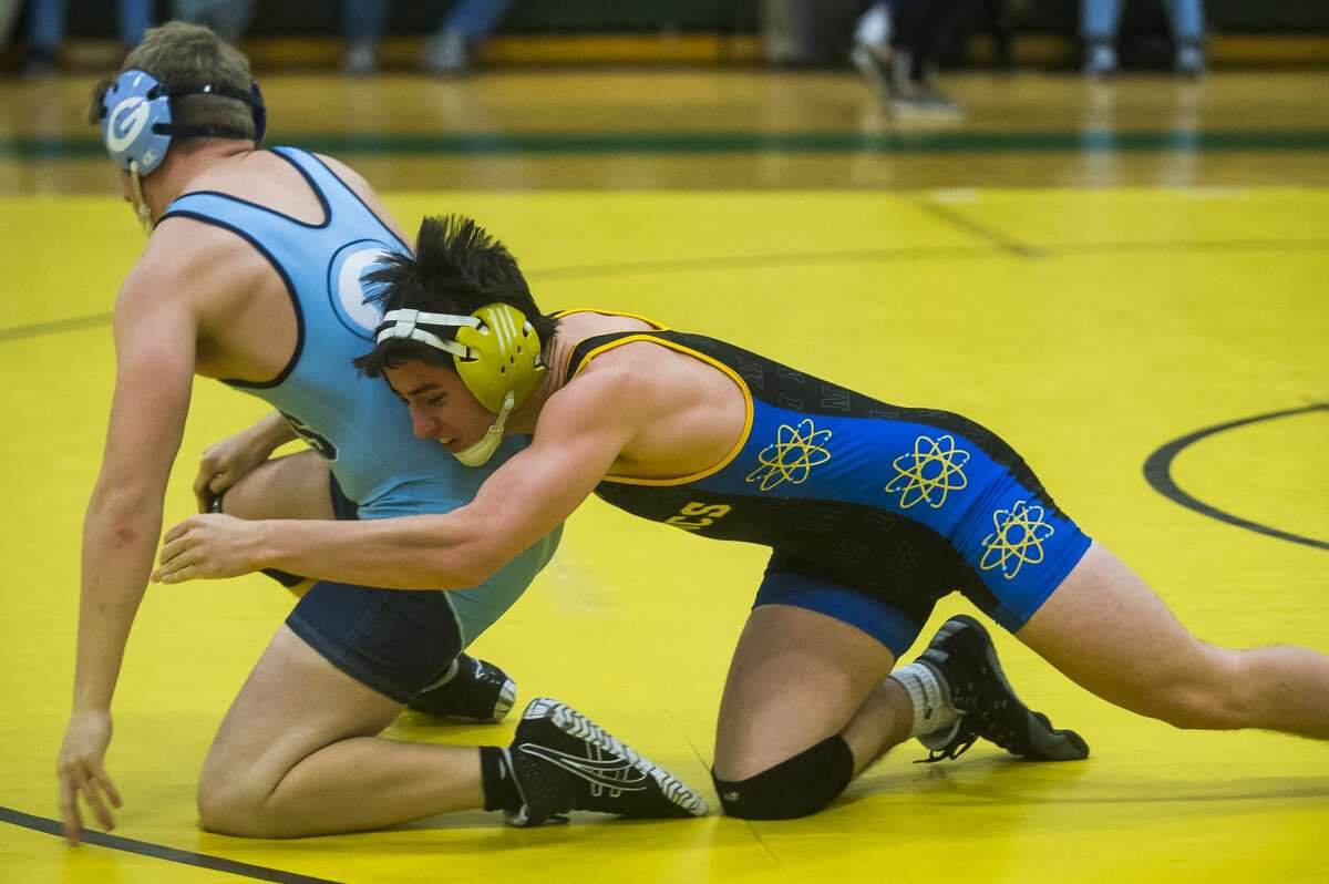 Midland High's Daniel Revord wrestles an opponent from Essexville Garber on Dec. 18, 2019. Revord was one of several Chemics who went undefeated at Wednesday's home quad, as MHS wrapped up the Saginaw Valley League championship.