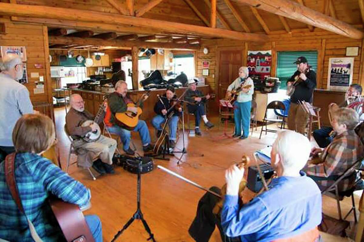 Musicians gather at the Wheatland Music Organization for its monthly acoustic jamboree session in 2016. (Pioneer file photo/Karin Armbruster)