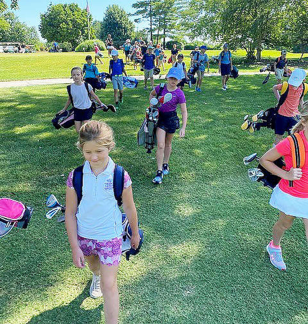 Golfers from the PGA Junior League during a practice session last year at Sunset Hills Country Club.
