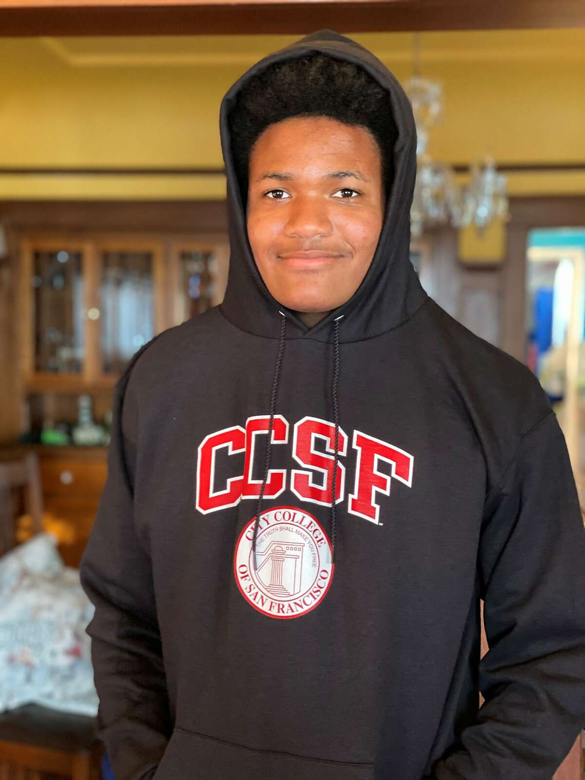 Zane Fisher-Paulson poses with his new City College of San Francisco sweatshirt, where he is now enrolled for the fall semester.