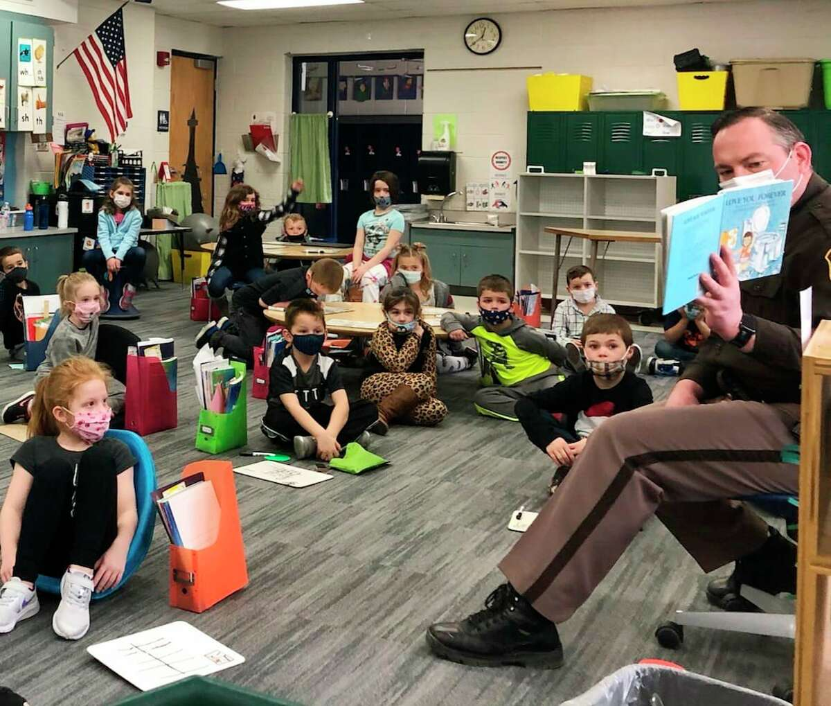 This week, Deputy Jason Losinski, with the Mecosta County Sheriff's Office, visited Riverview Elementary School in Big Rapids to read to Mrs. Zocco's class as part of March is Reading Month. (Photo courtesy of Mecosta County Sheriff's Office)