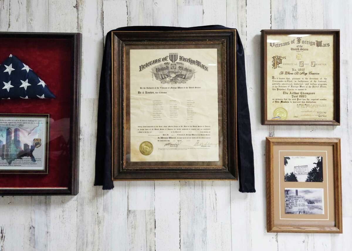 On the Wall of Honor, the charter for VFW Post 8905 is covered with a shroud in memory of three members who passed away during the month of February. It's been a tough year with more deaths this year in the membership than in recent years.