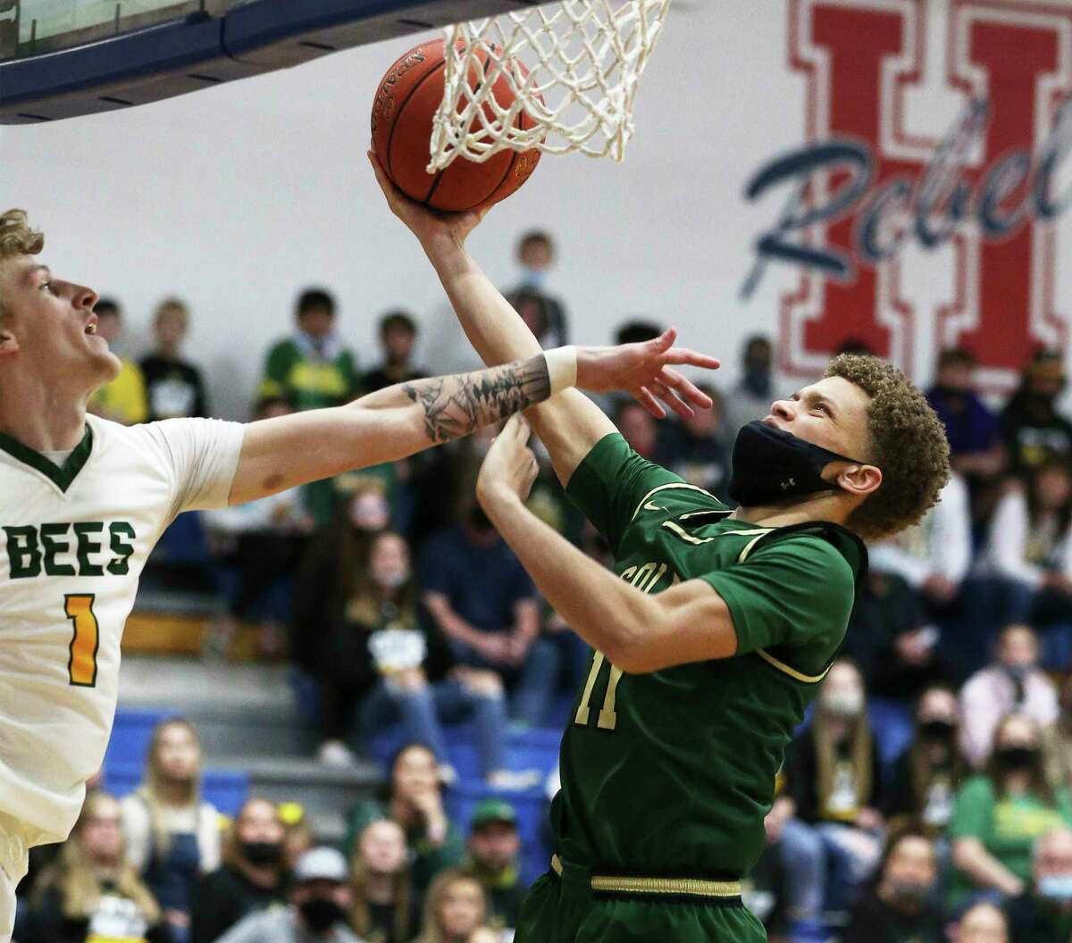Cole's Trey Blackmore (11) goes up for a shot against Little River Academy's Kollin Mraz (01) during the Class 3A state semifinal basketball game in Buda on Tuesday, Mar. 9, 2021. Cole defeated Academy, 59-50, to return the state finals.
