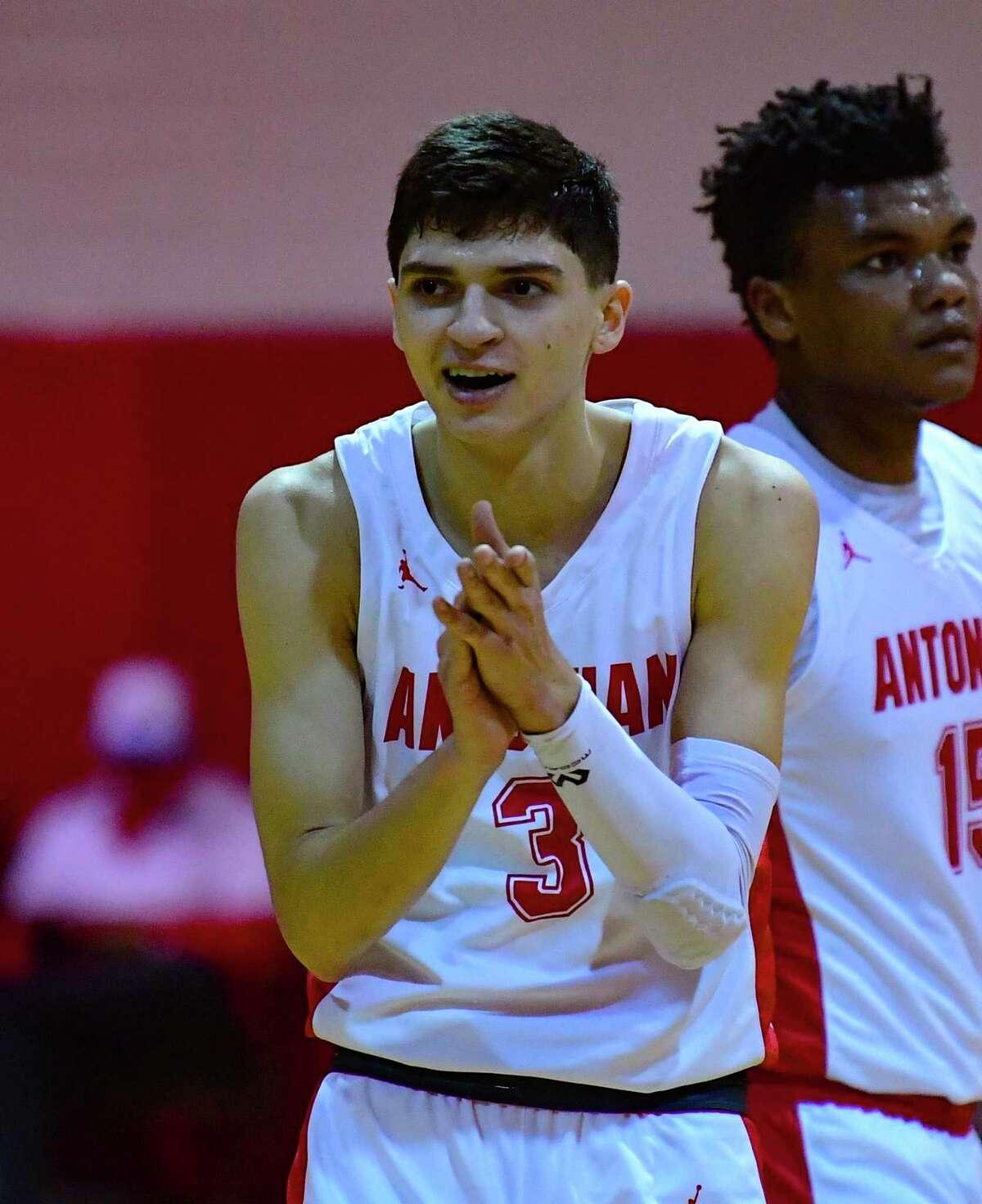 Gavino Ramos encourages teammates during high school basketball action against Central Catholic on Friday night, Feb. 5, 2021.