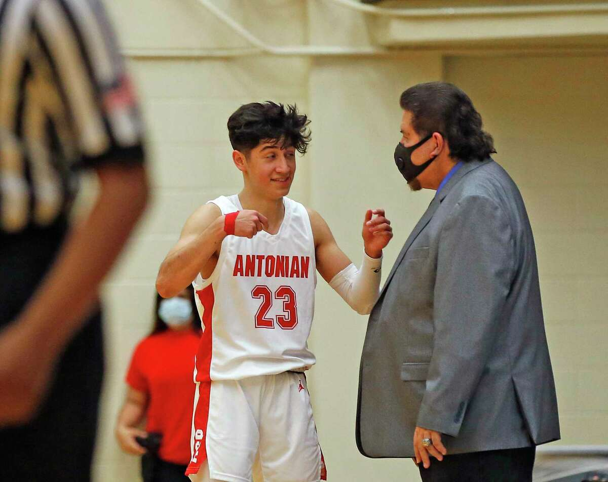 Antonian Xavier Martinez #23 confers with Antonian head coach Rudy Bernal in the second half. Antonian vs. Central Cathlolic in TAPPS Class 6A state quarterfinal on Saturday, March 6, 2021 at Lilleton Gym.