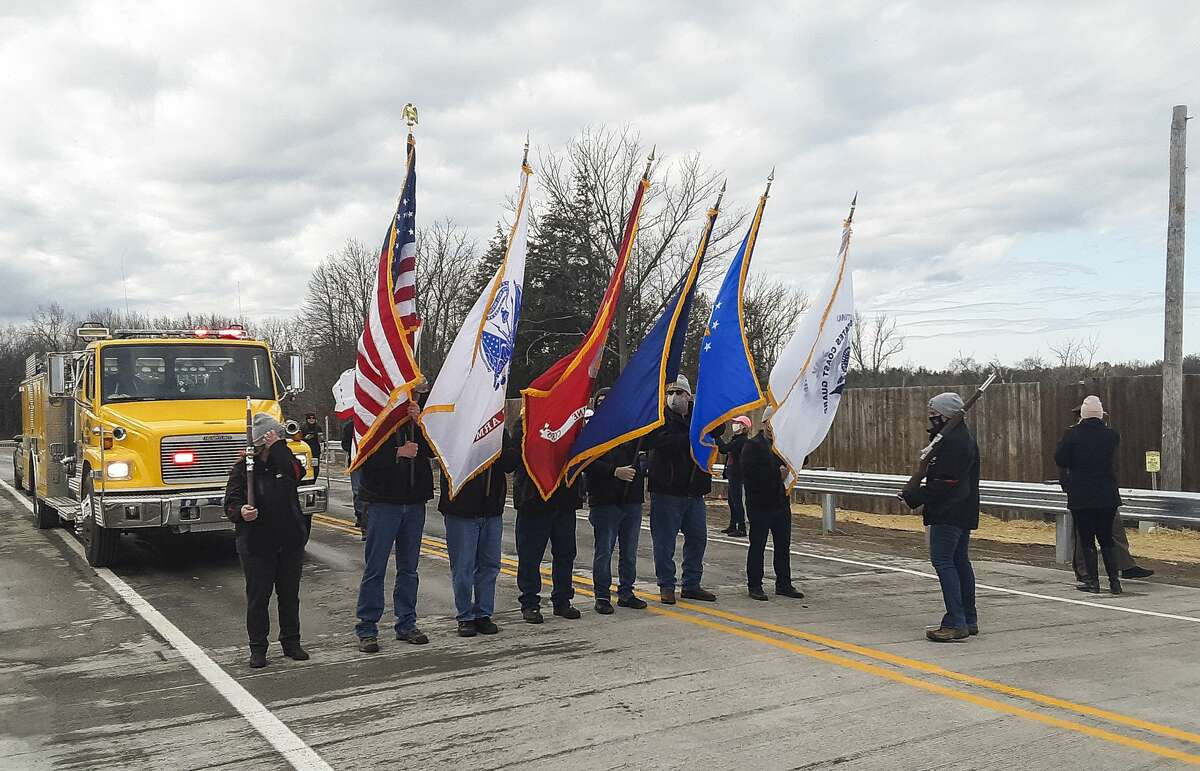 The Michigan Department of Transportation (MDOT) officially opens a 230-foot temporary prefabricated steel bridge over the Tobacco River, as dozens of area residents and elected officials walk over the span to celebrate the milestone Thursday, March 11, 2021 in Edenville. (Dan Chalk/chalk@mdn.net)