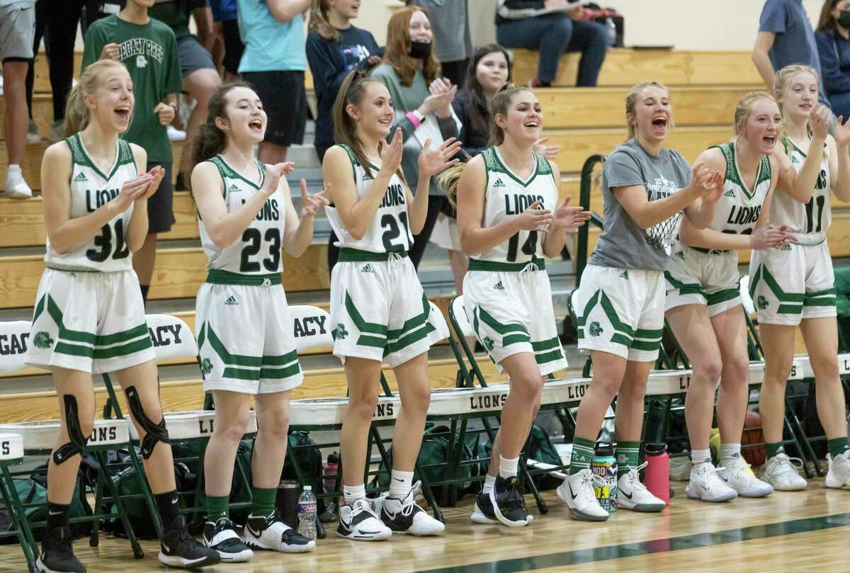 Legacy Preparatory Christian Academy's basketball girls react after their team scores during the third quarter of a TAPPS Class 4A Area girls basketball game against Westbury Christian at Legacy Preparatory Christian Academy, Tuesday, March 02, 2021, in Magnolia.