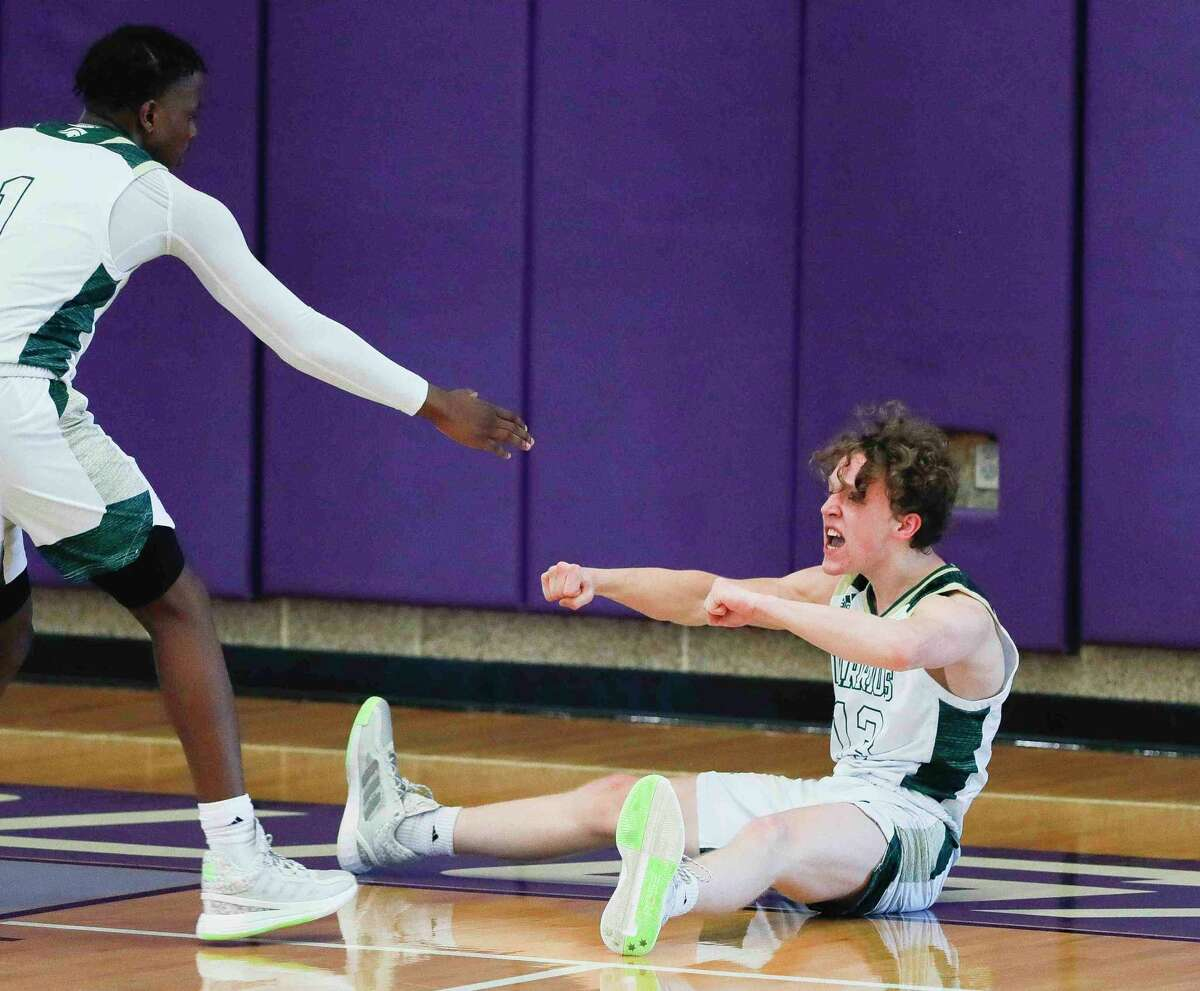 The Woodlands Christian Academy's Austin Benigni (13) reacts after taking a charge during the second quarter of a TAPPS Class 5A regional playoff game at College Station High School, Saturday, March 6, 2021, in College Station.
