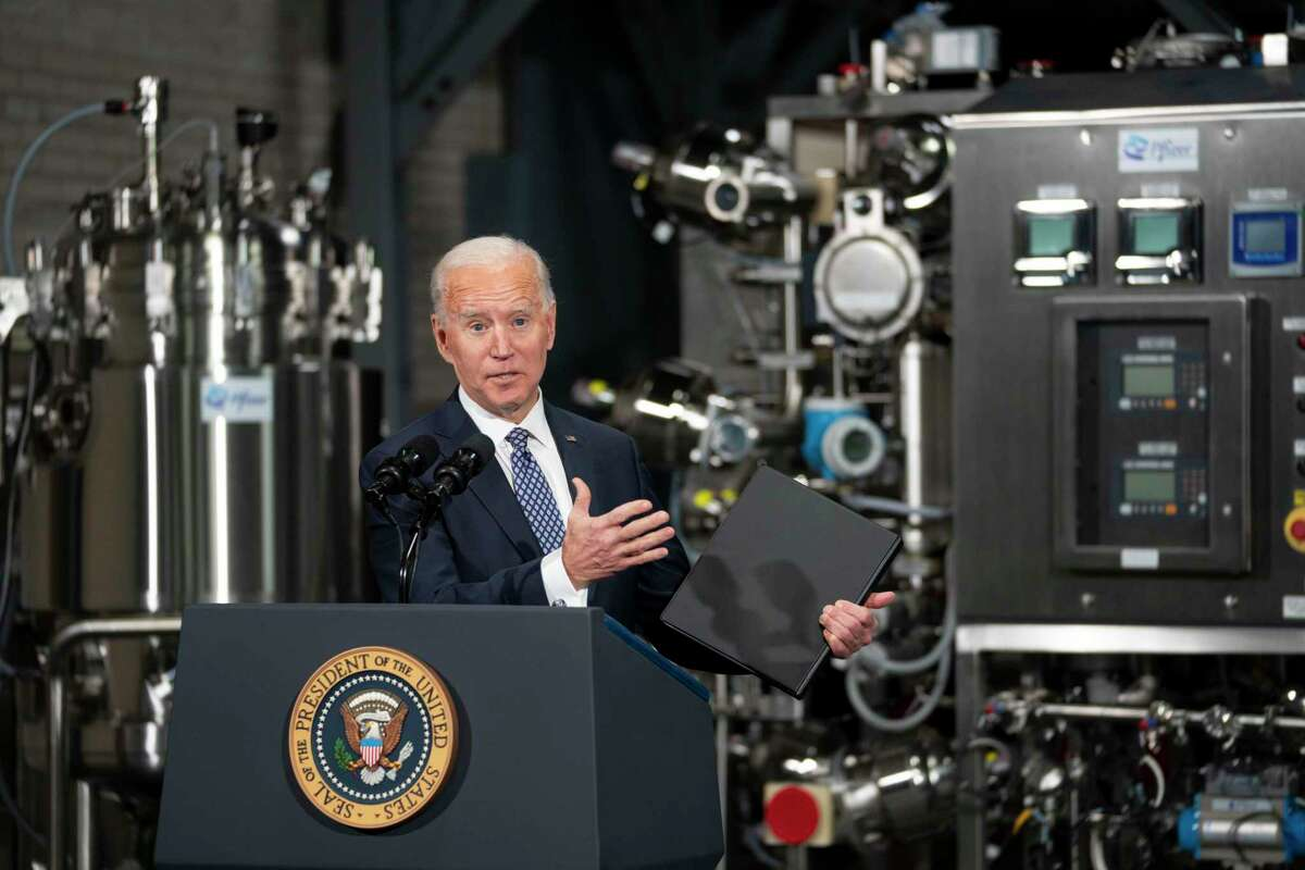 President Joe Biden speaks at a Pfizer COVID-19 vaccine manufacturing site in Michigan last month. Improved vaccine distribution coupled with his economic rescue plan signals optimism for 2021.