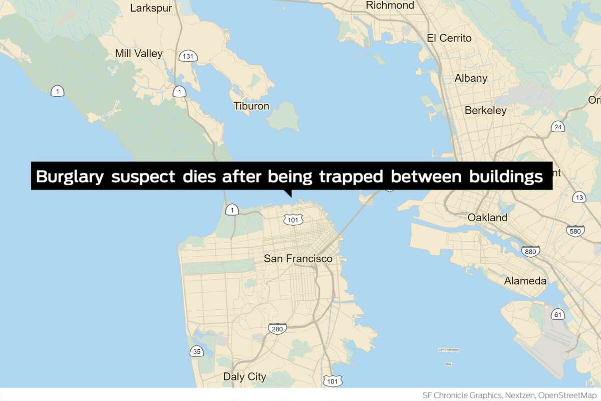 A man suspected of burglary died in San Francisco Tuesday after wedging himself into a confined space between two buildings while fleeing investigators, police said Thursday.