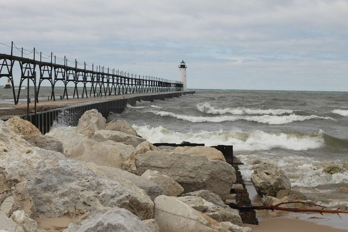 Waves crash along the Fifth Avenue Pier on Thursday.