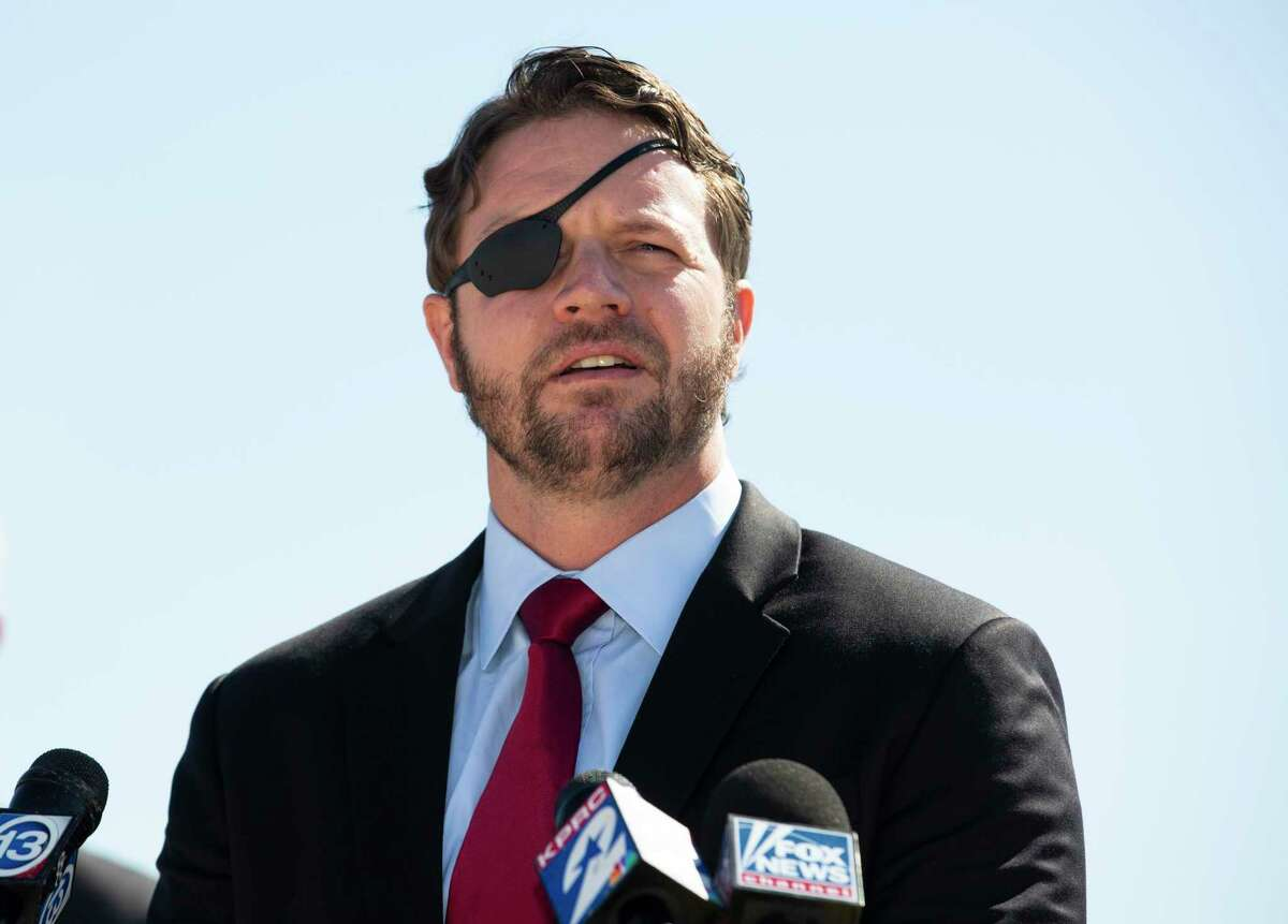 U.S. Representative Dan Crenshaw talks about the negative impact President Joe Biden's energy policies a during press conferenceTuesday, Feb. 2, 2021, at Houston Ship Channel in Houston. Mmbers of the Republican Houston delegation participated the roundtable with Texas oil and gas workers.