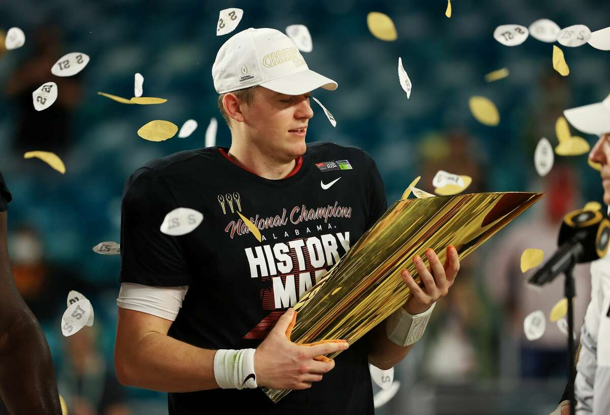 Mac Jones of the Alabama Crimson Tide holds the trophy following their win over the Ohio State Buckeyes in the College Football Playoff National Championship game on Jan. 11, 2021.