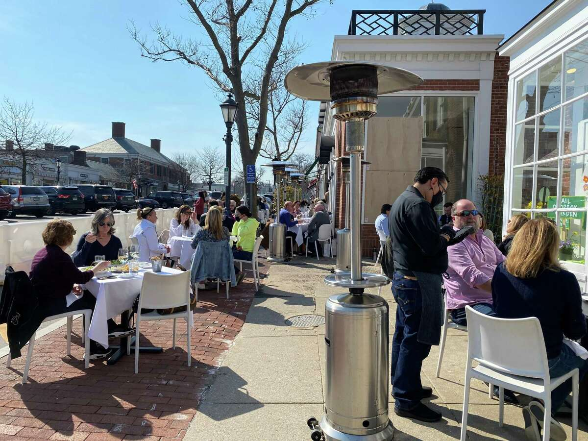 People dined in New Canaan outdoors during the winter, but many more came out to Sole and other restaurants on Elm Street on a beautiful sunny spring-like day, Thursday, March 11, 2021.