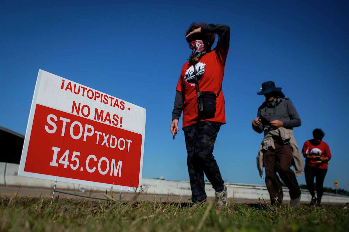 Participants walk through Fifth Ward during a protest of the Interstate 45 expansion on Dec. 6, 2020. Regional transportation officials Friday approved a nonbinding resolution in support of the $7 billion rebuild.