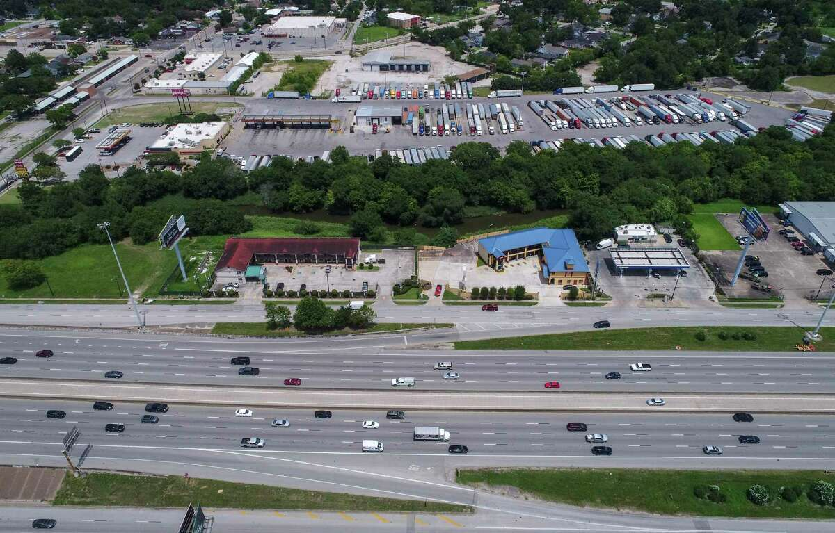 Traffic passes by the Love's Travel Stop, near Interstate 45 and Patton Street, on July 5, 2019, in Houston. The truck stop is one of more than 300 businesses affected by a planned freeway widening.