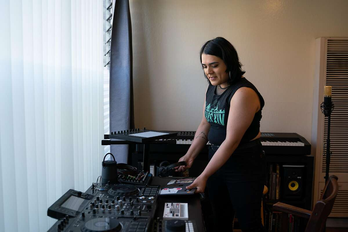 Frida Ibarra, 31, sets up her laptop for DJing inside her new apartment in Oakland.