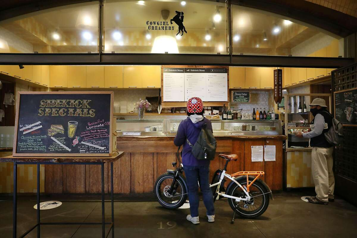 Sherry Yamamoto (center) of San Francisco looks over the menu at Cowgirl Creamery's Sidekick Cafe at the Ferry Building.