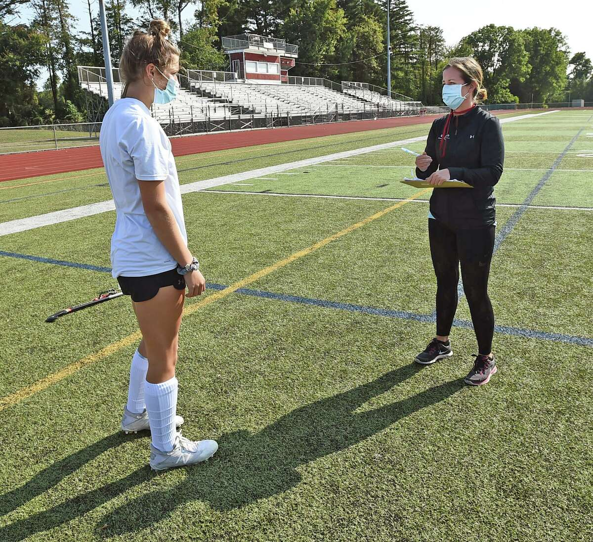 Cheshire field hockey coach Eileen Wildermann, right, is stepping down after 13 seasons with the Rams.