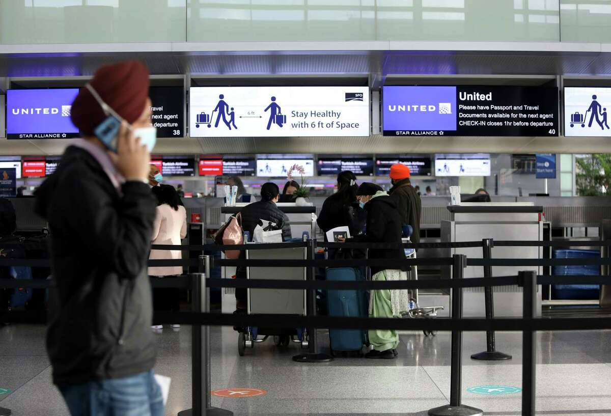 Travelers stand in line at the United Airlines check-in at San Francisco International Airport. With summer approaching, it seems more and more Californians are zeroing in on travel destinations, especially to places like Vegas, Hawaii and Miami.