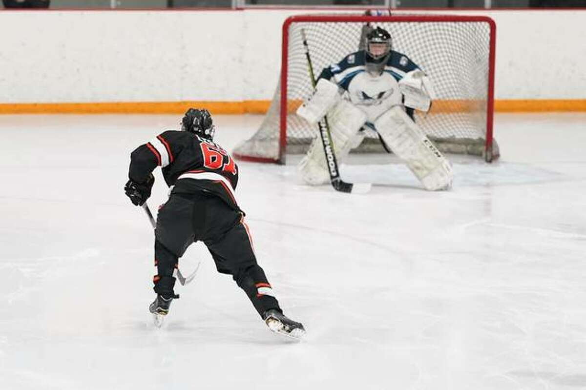 Edwardsville's Adam Leston skates in on a breakaway against Columbia during Tuesday's game in East Alton.