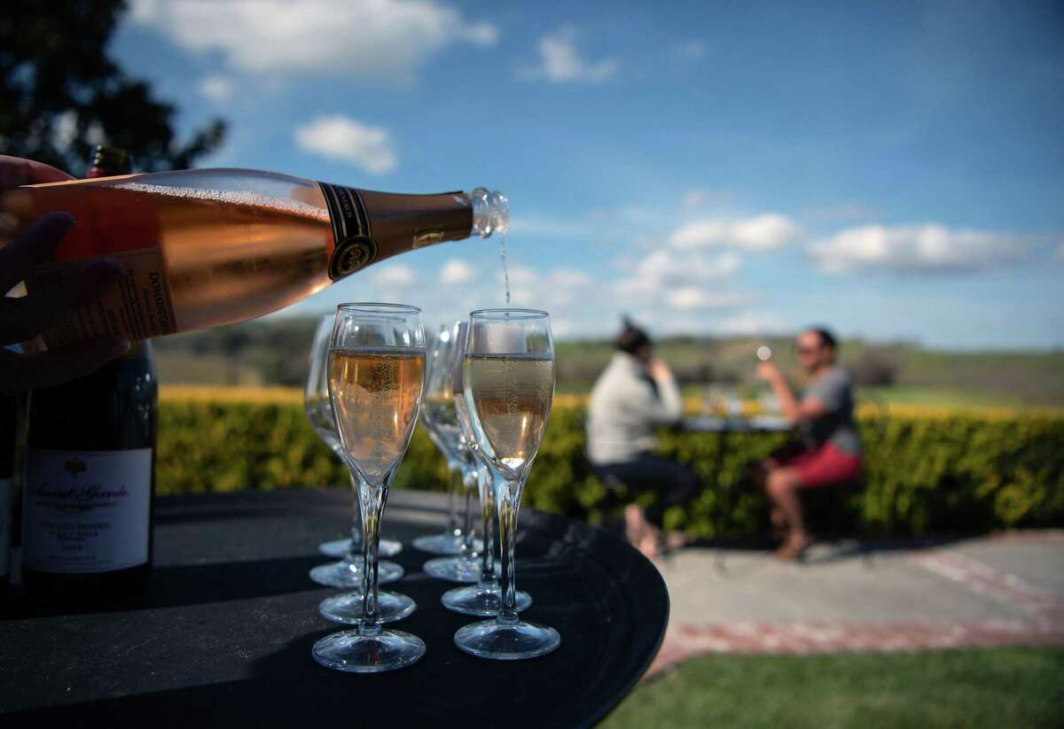 Patrons taste wine at Domaine Carneros winery in Napa on March 05, 2021.