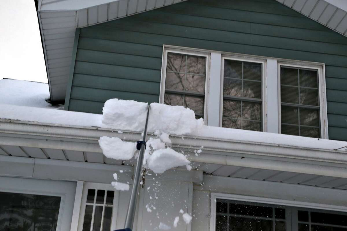 Cleaning gutters and raking the roof to remove snow can help prevent ice dams.