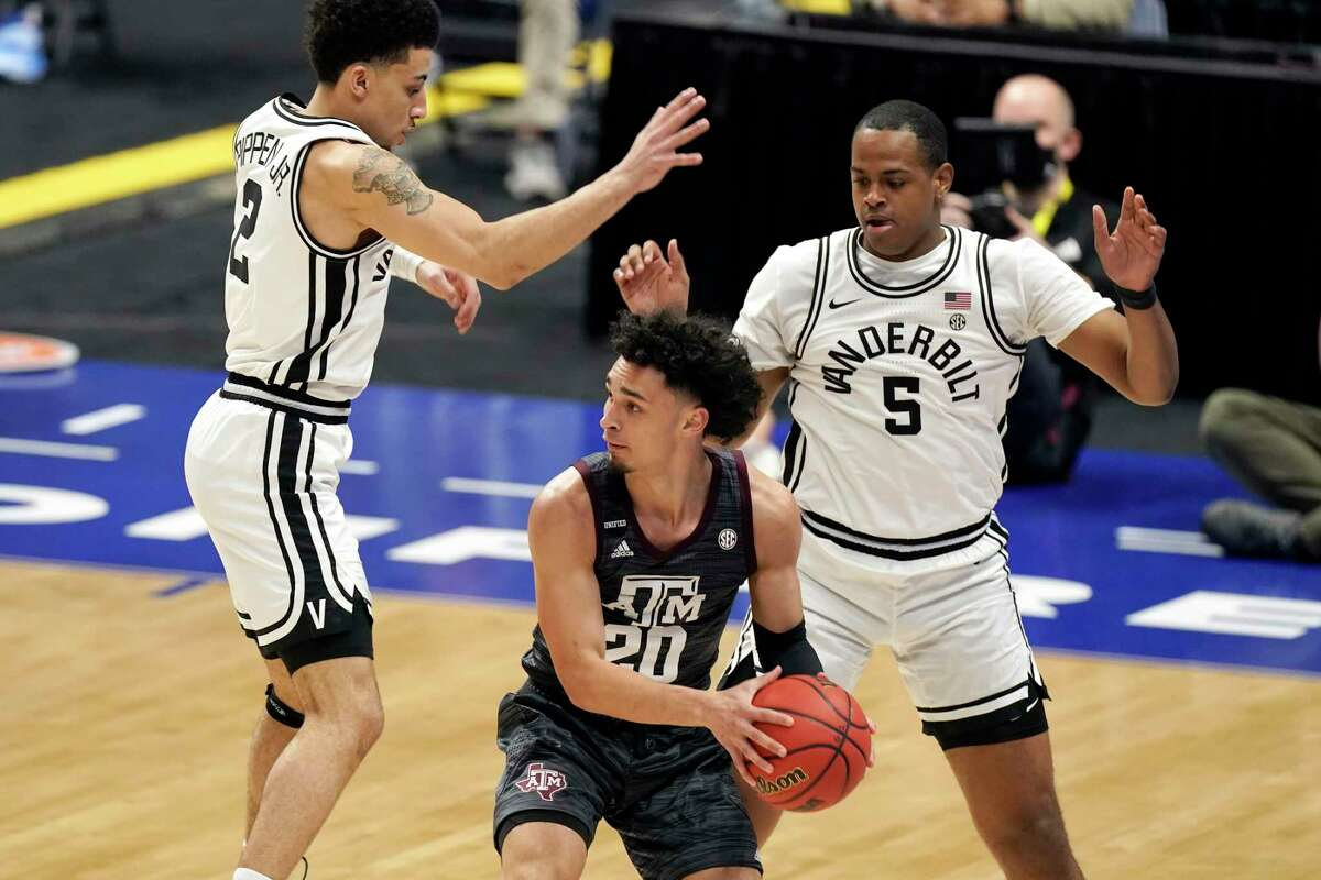 Vanderbilt's Scotty Pippen Jr. (2) and D.J. Harvey pressure Texas A&M guard Andre Gordon in the Commodores' 79-68 victory in Wednesday night's SEC tournament opener.