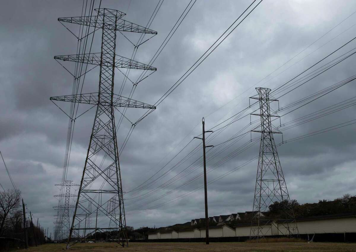 Power lines are photographed Wednesday, Feb. 24, 2021, in Houston.