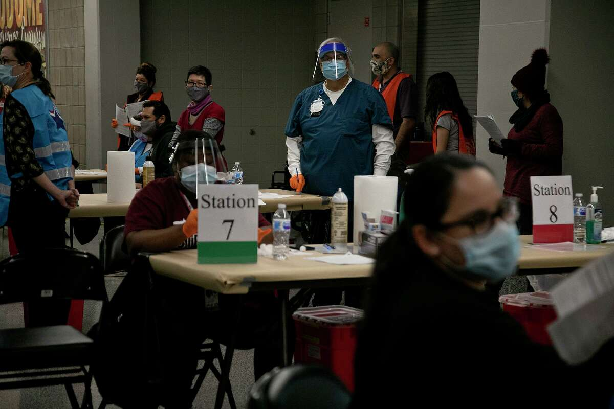 Volunteers and medical personnel stand by to administer vaccines at the City of San Antonio's Alamodome COVID-19 Vaccine Site on Monday, Jan. 11, 2021.