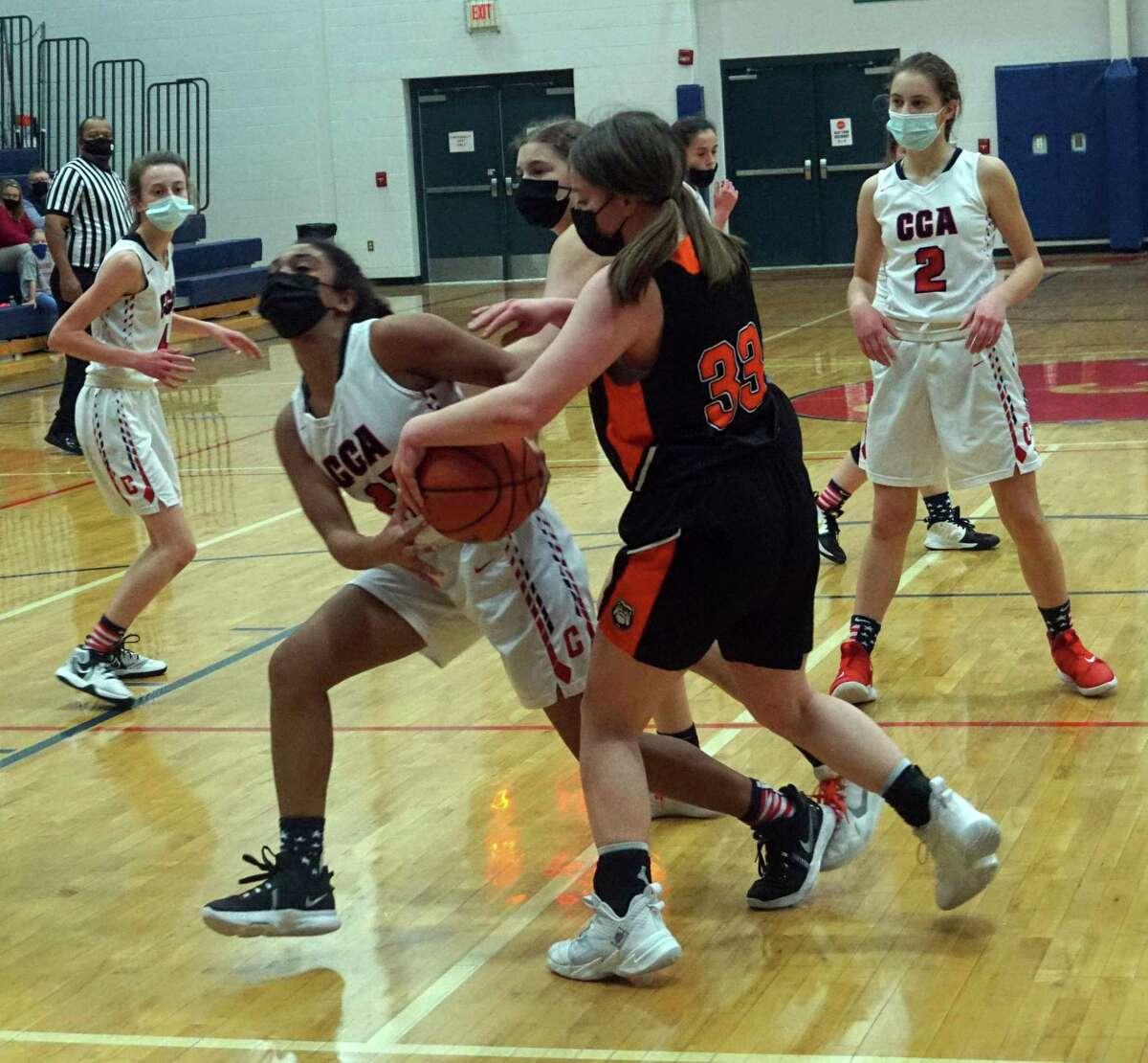 Crossroads Charter Academy's Samara Turner battles for possession of the ball with Mesick's Mattie Akom during Thursday night's girls' basketball game. (Pioneer photo/Joe Judd)