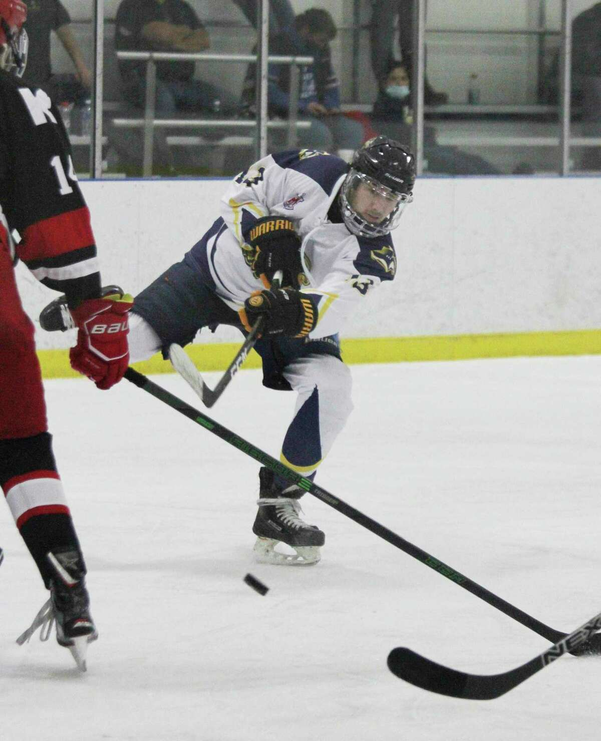 The Lakeshore Badgers' Mateo Barnett, of Manistee Catholic, fires a shot Wednesday at West Shore Community Ice Arena. (Dylan Savela/News Advocate)