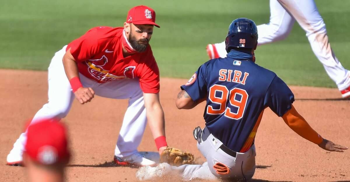Matt Carpenter #13 of the St. Louis Cardinals tags out Jose Siri #99 of the Houston Astros during the Spring Training game at Roger Dean Chevrolet Stadium on March 7, 2021 in Jupiter, Florida. (Photo by Eric Espada/Getty Images)