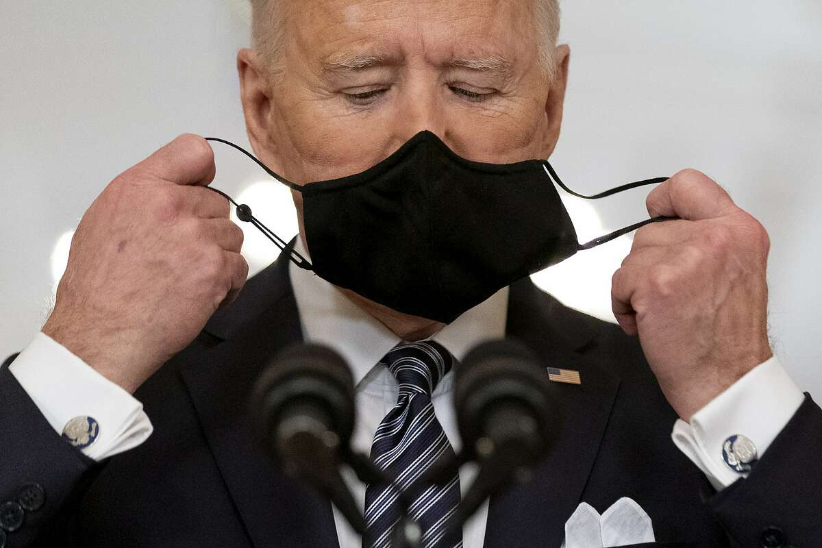 President Biden takes off his mask to speak about the COVID-19 pandemic during a prime-time address.