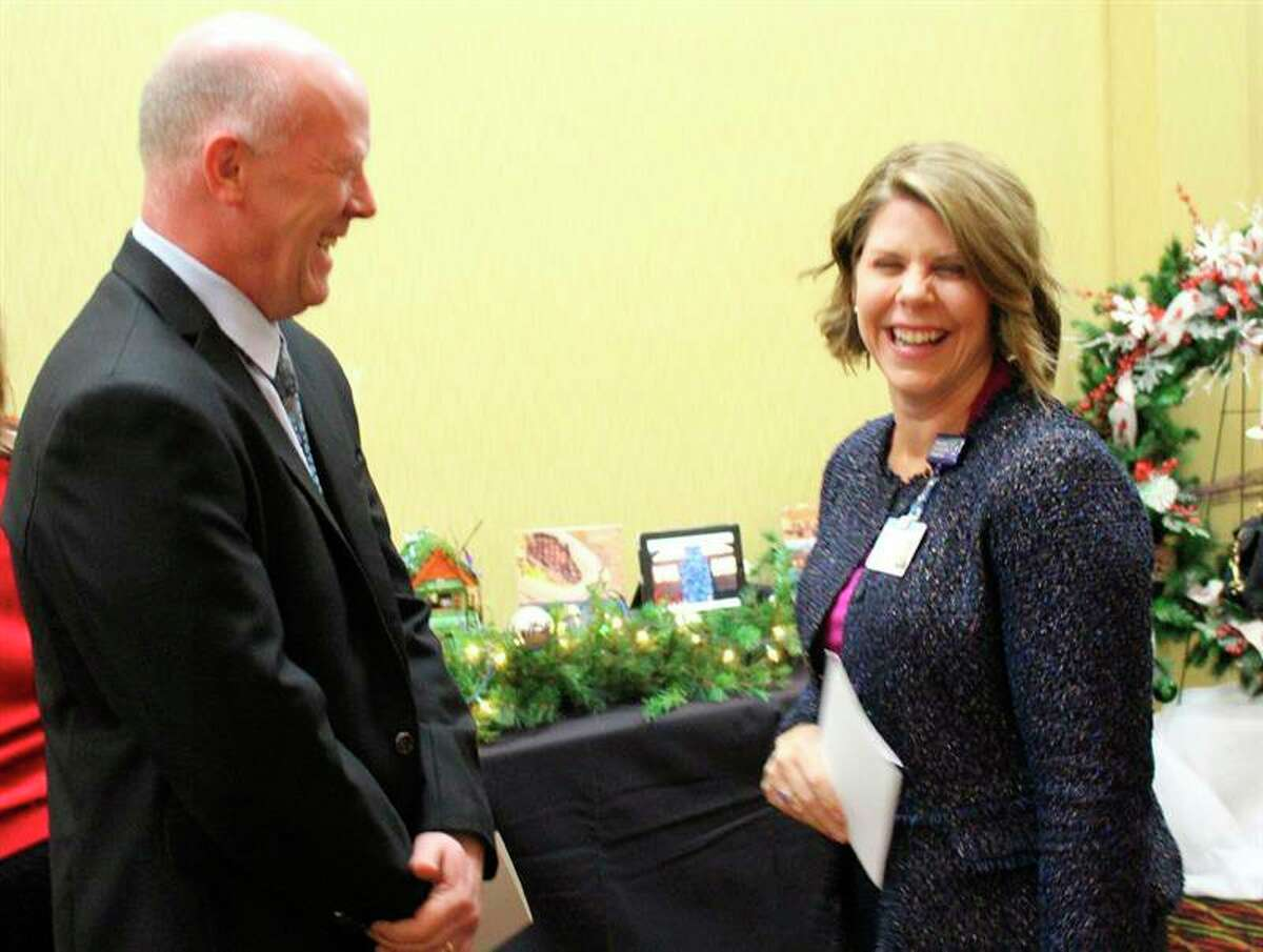 In this file photo, Andrea Leslie is pictured sharing a laugh with Spectrum Health manager of community education Scott Lombard at 2019 Festival of Trees. Leslie is the president of Spectrum Health Big Rapids, Reed City, United and Kelsey hospitals. (Courtesy photo)