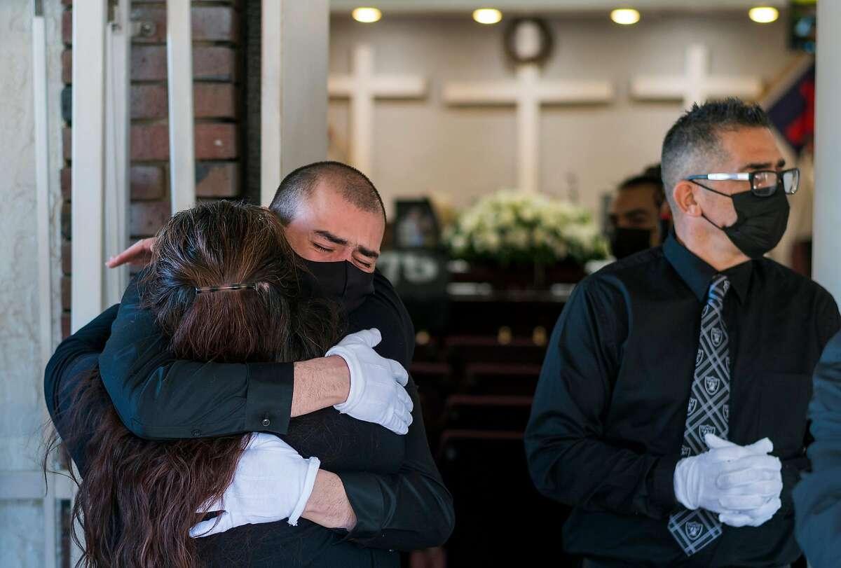 Friends and family mourn Carmelita Martinez outside Pastor El Buen Church in San Jose.