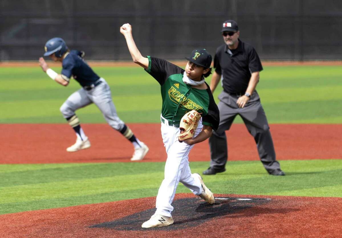 Klein Forest pitcher Justin Barnes (21) throws the ball during the first inning of a Baseball Tournament against Lake Creek at Grand Oaks High School, Thursday, March 11, 2021 in Spring.