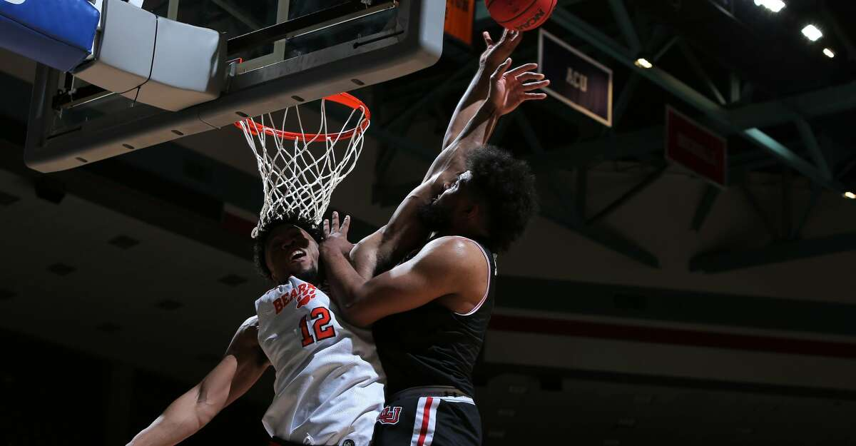 Lamar forward Avery Sullivan is fouled while attempting a layup on the Cardinals' last possession of a 70-69 win over Sam Houston in Katy.