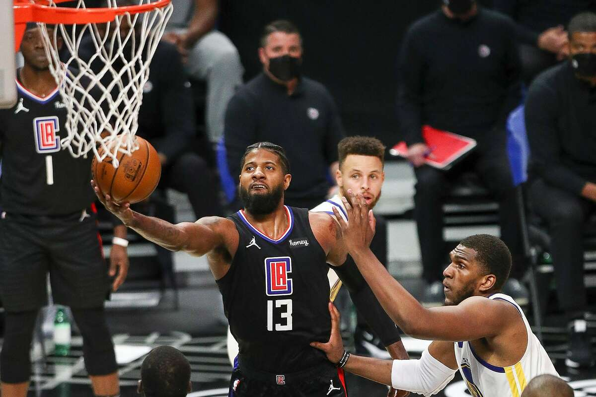 LOS ANGELES, CALIFORNIA - MARCH 11: Paul George #13 of the LA Clippers shoots guarded by Kevon Looney #5 of the Golden State Warriors in the first half at Staples Center on March 11, 2021 in Los Angeles, California. NOTE TO USER: User expressly acknowledges and agrees that, by downloading and or using this photograph, User is consenting to the terms and conditions of the Getty Images License Agreement. (Photo by Meg Oliphant/Getty Images)
