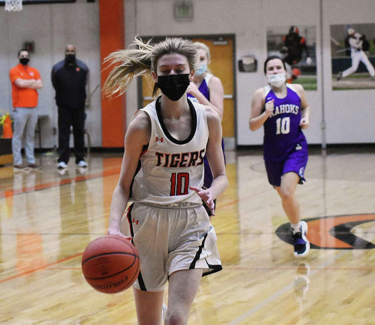 Edwardsville's Ashlyn Hauk drives to the basket for a layup after a Collinsville turnover in the second half of Thursday's game.