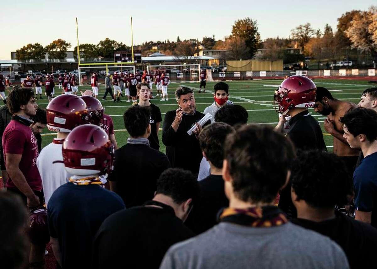 Cardinal Newman-Santa Rosa coach Paul Cronin, addresses his players after practice on Thursday.