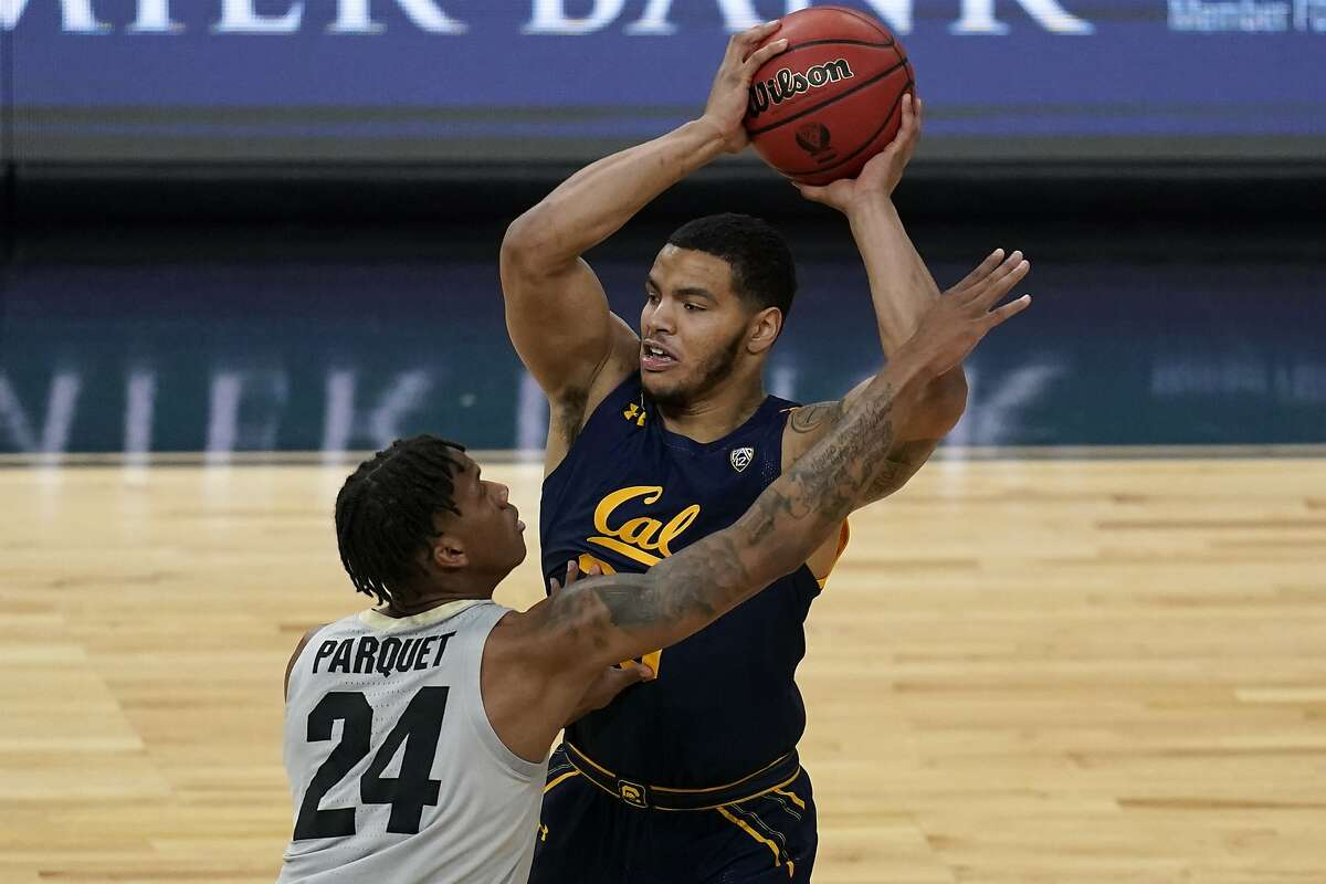 Cal's Matt Bradley (20) looks to pass around Colorado's Eli Parquet (24) during the first half of an NCAA college basketball game in the quarterfinal round of the Pac-12 men's tournament in Las Vegas.