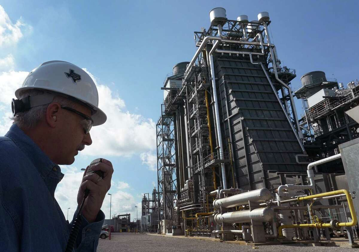 In this file photo, General Manager Darryl Nitschke talks on the radio as he makes the rounds of the Panda Power Plant in Sherman, north of Dallas. A shortage of natural gas has been blamed for much of generating outages during the recent winter storm. ,
