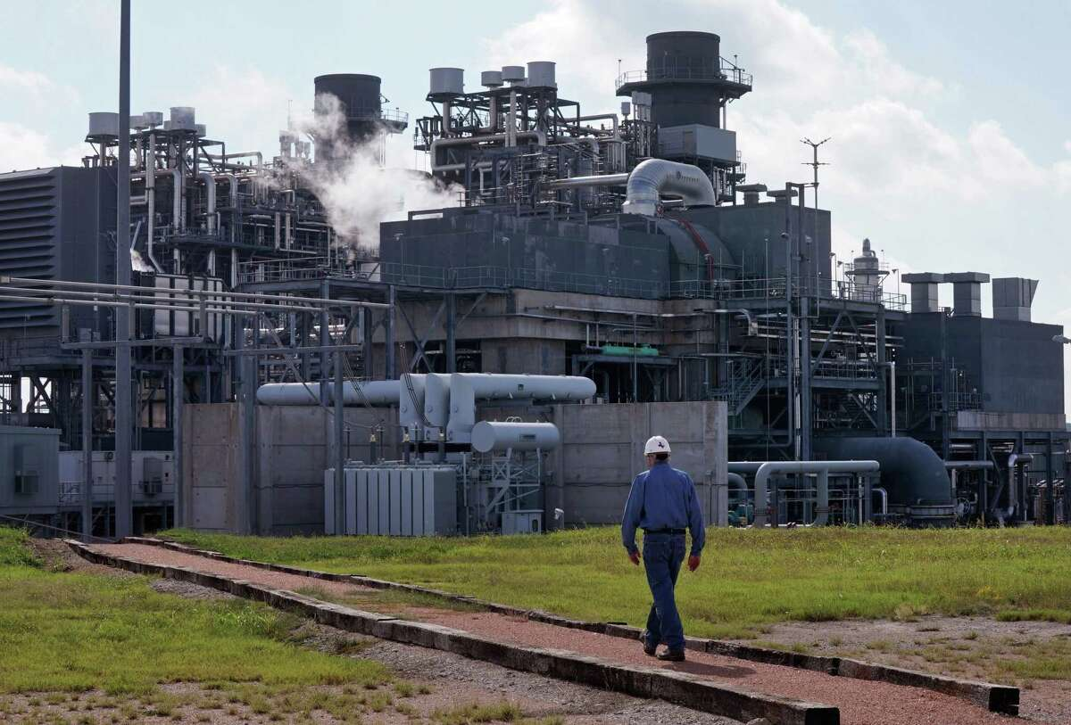 In this file photo, General Manager Darryl Nitschke talks on the radio as he makes the rounds of the Panda Power Plant in Sherman, north of Dallas. A shortage of natural gas has been blamed for much of generating outages during the recent winter storm.