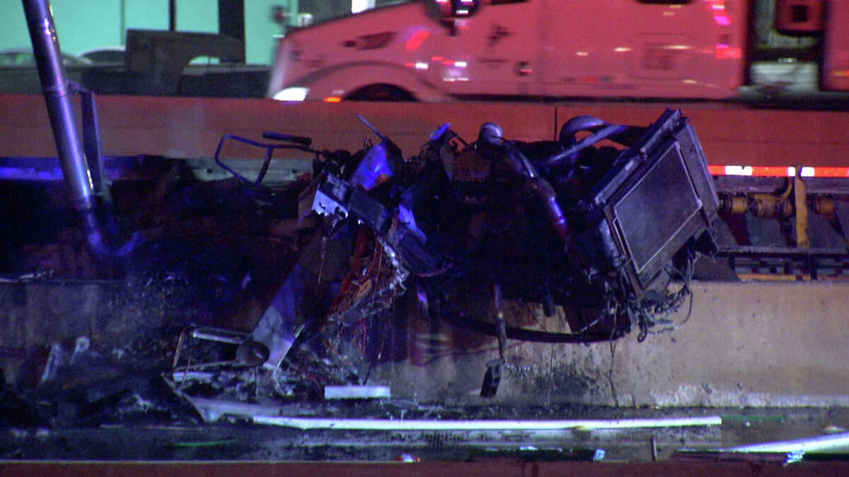 Part of Interstate 10 near Foster Road has been shut down for several hours after an 18-wheeler crashed in a construction zone, catching fire and spilling its contents onto the highway, San Antonio police said.