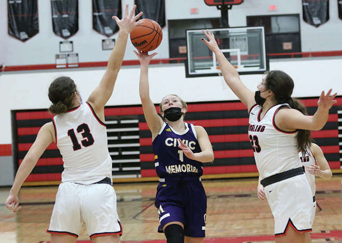 CM's Tori Standefer (1), shown shooting over Highland's Bella LaPorta (13) and Taylor Kesner in a Feb. 18 game in Highland, closed her career Thursday night in Bethalto by scoring 20 points in a MVC win over Mascoutah.
