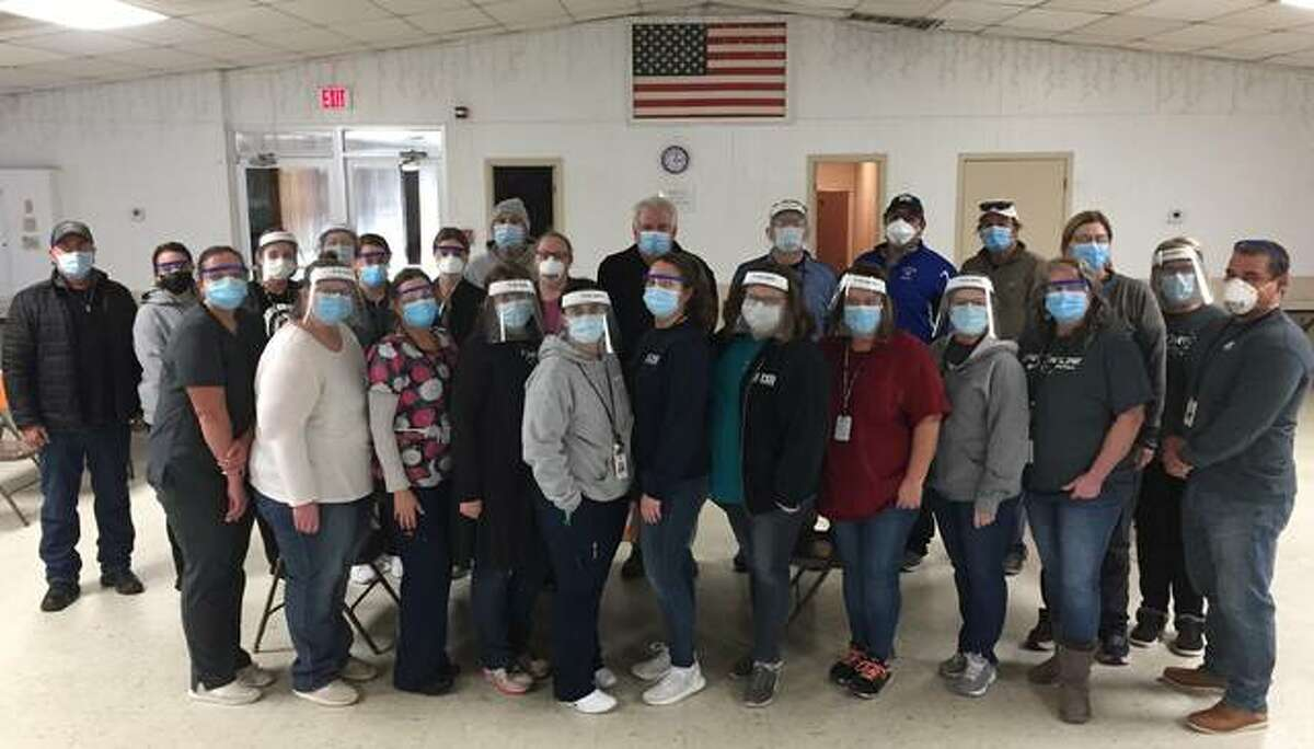 Members of the Macoupin County Health Department's vaccination effort gather for a group photo at a recent clinic. County health department CEO Kent Tarro said the overriding majority of residents have been exceedingly grateful and appreciative of receiving the COVID-19 vaccines.