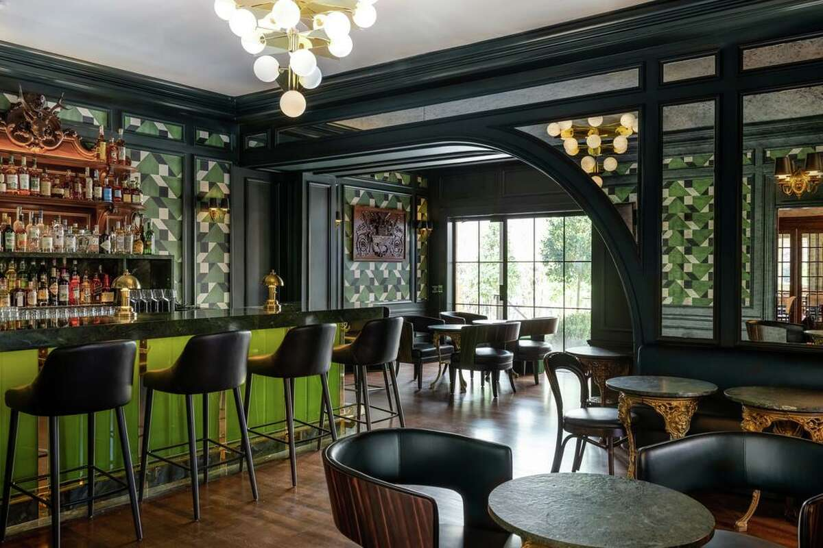 The La Colombe d'Or Hotel on Montrose Boulevard has a chic and elegant bar and lounge.