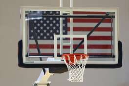 BALTIMORE, MARYLAND - MARCH 06: A U.S. Flag is seen behind a basketball goal during the NCAA Division III Men's Basketball Championship - First Round at Goldfarb Gymnasium on at Johns Hopkins University on March 6, 2020 in Baltimore, Maryland. On Thursday, Maryland Gov. Larry Hogan announced that Maryland had confirmed three cases of residents with COVID-19, otherwise known as the Coronavirus, prompting Johns Hopkins officials to host the NCAA men's basketball tournament without spectators. (Photo by Patrick Smith/Getty Images)
