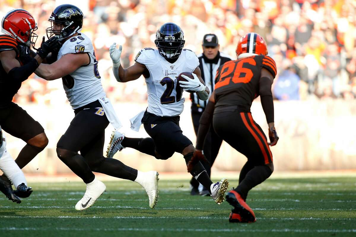 CLEVELAND, OH - DECEMBER 22: Mark Ingram II #21 of the Baltimore Ravens runs with the ball during the game against the Cleveland Browns at FirstEnergy Stadium on December 22, 2019 in Cleveland, Ohio. Baltimore defeated Cleveland 31-15. (Photo by Kirk Irwin/Getty Images)